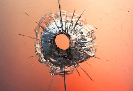 bullet hole in the window  photo