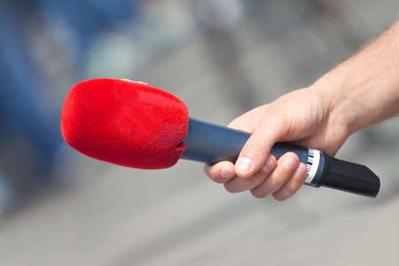Male hand holding microphone for the interview  photo