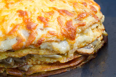 meat pie: Pancake pie with mushrooms and cheese