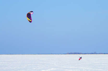 snowkiting: Winter Snowkiting on the ice lake Stock Photo