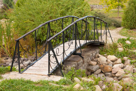 Beautiful footbridge in the summer . photo