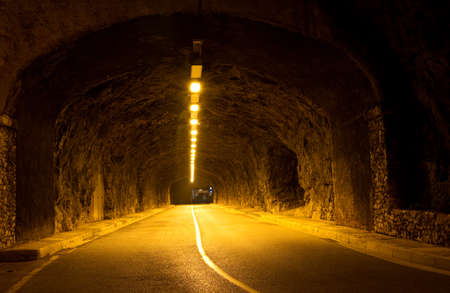 Illumination Tunnel in the rock in Monaco photo