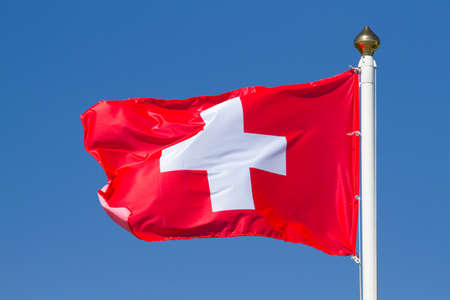 Flag of Switzerland on a background sky photo