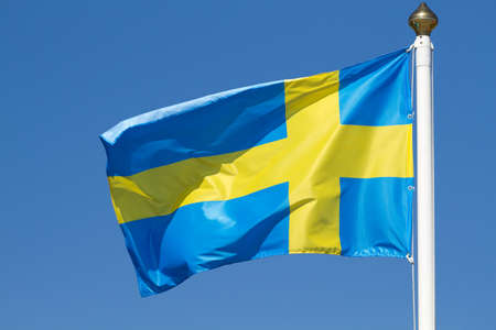 Flag of Sweden on a background sky photo