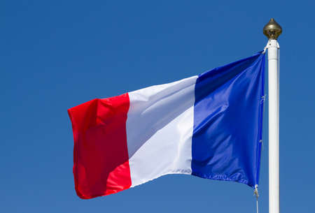 Flag of France, waving on the sky photo