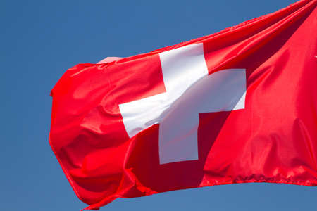swiss culture: Flag of Switzerland on a background sky