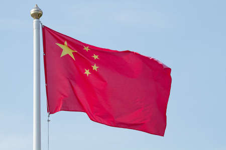 Chinese national flag with blue sky photo