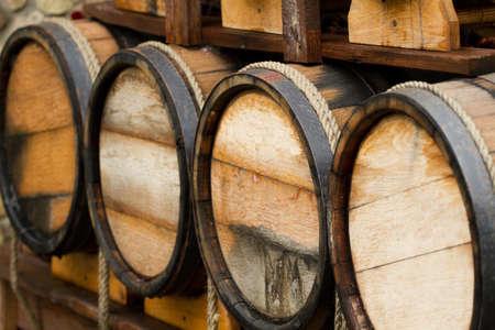 Wooden wine barrels - background   photo