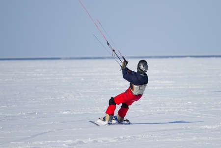 Winter Snowkiting on the lake photo
