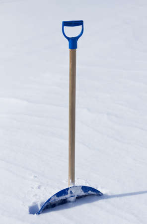Snow shovel in winter Stock Photo