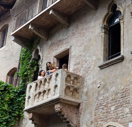 romeo and juliet: VERONA, ITALY - JUNE 11, 2010:Tourists visit on famous balcony of Romeo and Juliet in Verona, Italy Editorial