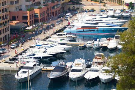 MONTE CARLO, MONACO - JUNE 10,2010:Fashionable boats and yachts of the harbor in  marina at Monte Carlo, Monaco.