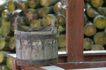 draw well: Old wooden bucket near a well Stock Photo