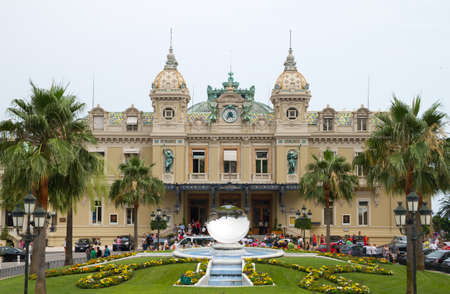 carlo: MONTE CARLO, MONACO - JUNE 10,2010: Front of the Grand Casino in Monte Carlo, Monaco. The Casino is one of the most notable buildings in Principality.