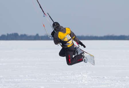 snowkiting: Man winter snowkiting on a frozen lake