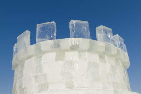 frigid: Ice castle on the blue sky Stock Photo