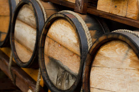 wine barrel: Wine barrels stacked in the old cellar of the winery