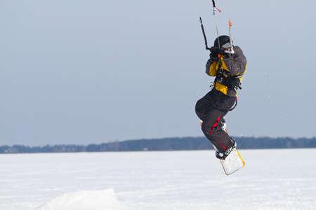 snowkiting: Man jumps on a snowkiting in winter