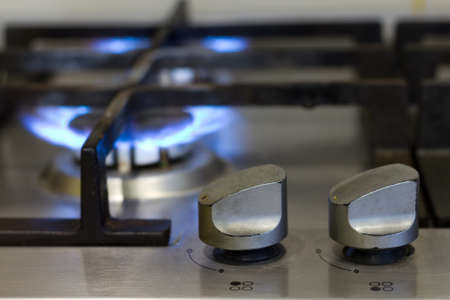 Turns on gas stove with burning flame photo