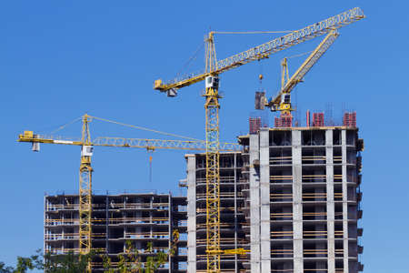 crane tower: Cranes and building construction on the blue sky Stock Photo