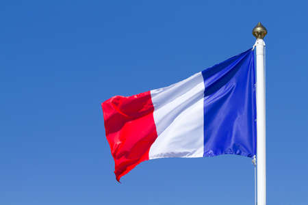 Flag of France waving on the blue sky Stock Photo - 34421188