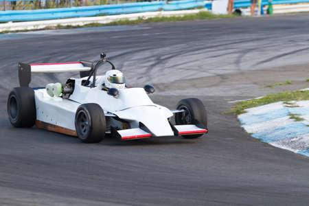 highway 3: Formula three  race car on a speed track