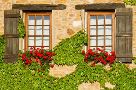 french countryside: Beautiful window with shutters in Provence, France . Stock Photo