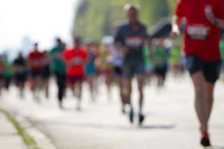 Blurred mass of marathon runners photo