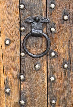 doorknocker: Old doorknocker of a wooden door Stock Photo