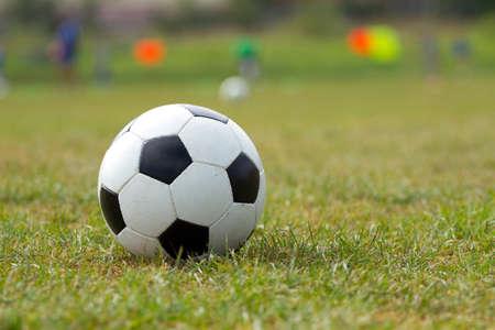 indoor soccer: Soccer ball on the football stadium Stock Photo