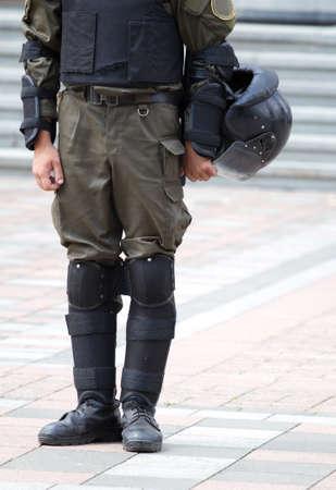 mobilization: Soldier in uniform and helmet in his hands Stock Photo