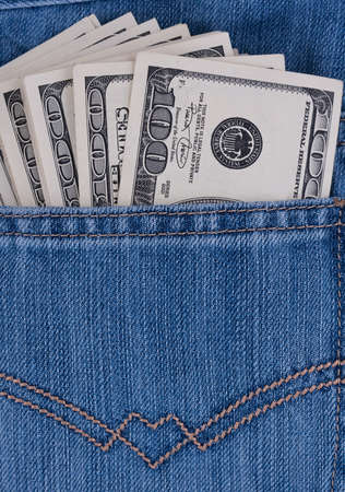 cloth back: Dollars in the pocket of jeans Stock Photo