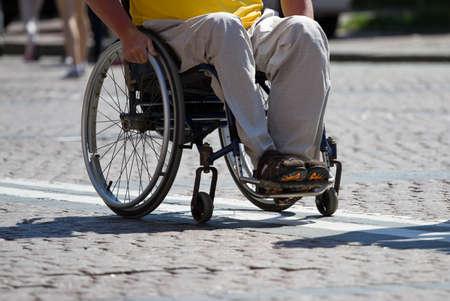 disability: Disabled man rides a wheelchair