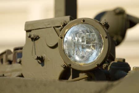 army tank: Headlight close-up on a military tank
