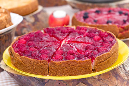 sweet tart: Sweet tart with red  raspberries on a table Stock Photo
