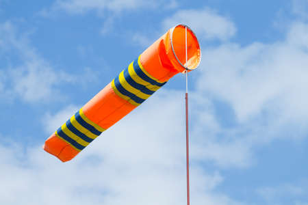 windsock: Wind flag windsock in airport on the background blue sky Stock Photo
