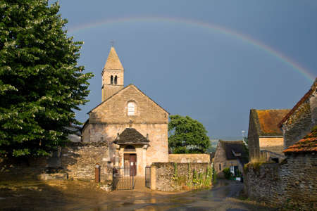 christian community: Church with a rainbow of Taize in Burgundy. France. Stock Photo