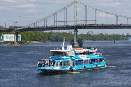 dnepr: KIEV,UKRAINE - MAY 02, 2016: Tourist pleasure boats on the Dnepr River and river shore in historical area. Kiev. Ukraine