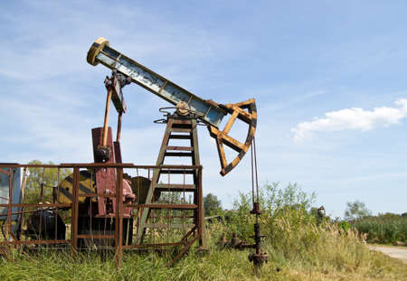 Oil pump on the background blue sky Stock Photo