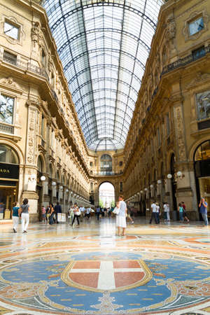 Milan, Italy - June 11, 2010: Some people walks by the Gallery Emanuele Vittorio, famous shopping mall of Europe
