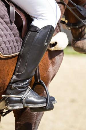stirrup: Jockey riding boot in the stirrup Stock Photo