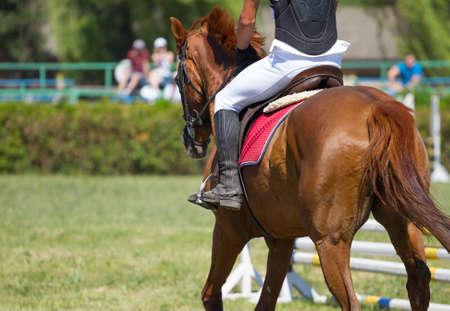 Jockey riding boot in the stirrup Stock Photo