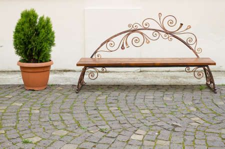 Decorative bench and flower pot with cobblestone
