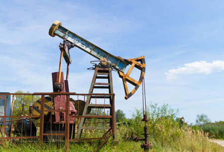 Industrial oil pump jack pumping crude oil Stock Photo