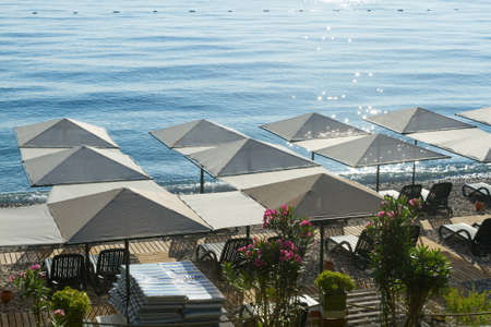 Beach umbrellas with sunbeds  in Kemer, Turkey