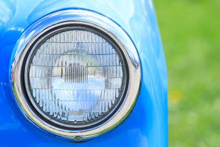 Front headlamp of a retro car close up