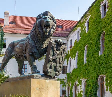 Bronze sculpture of lion on the yard of Strahov Monastery in Prague, Czech Republic