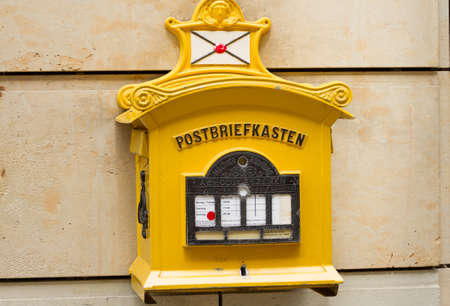 Dresden, Germany - April 6, 2010: Yellow post box on the historic place in Dresden, Germany