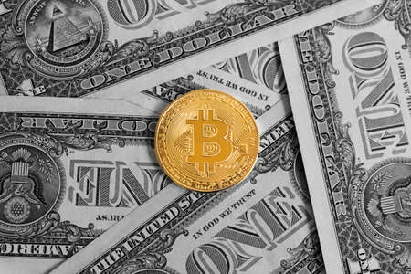 Golden Bitcoin on black and white US dollar banknotes background. ( Digital currency or Cryptocurrency )