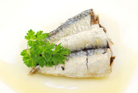 sardines: Healthy sardines in olive oil and parsley Stock Photo